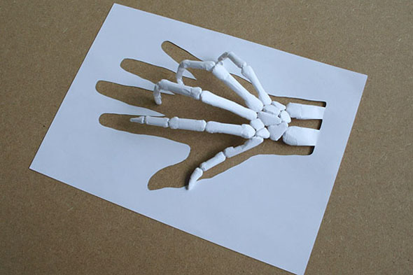 skeleton hand by Peter Callesen