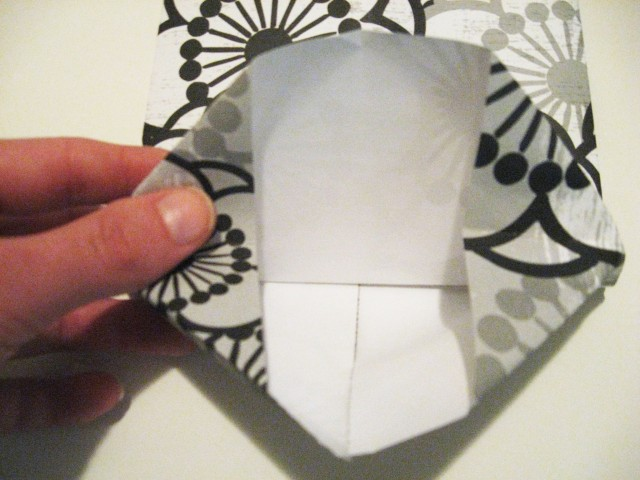 folded bottom of paper bag