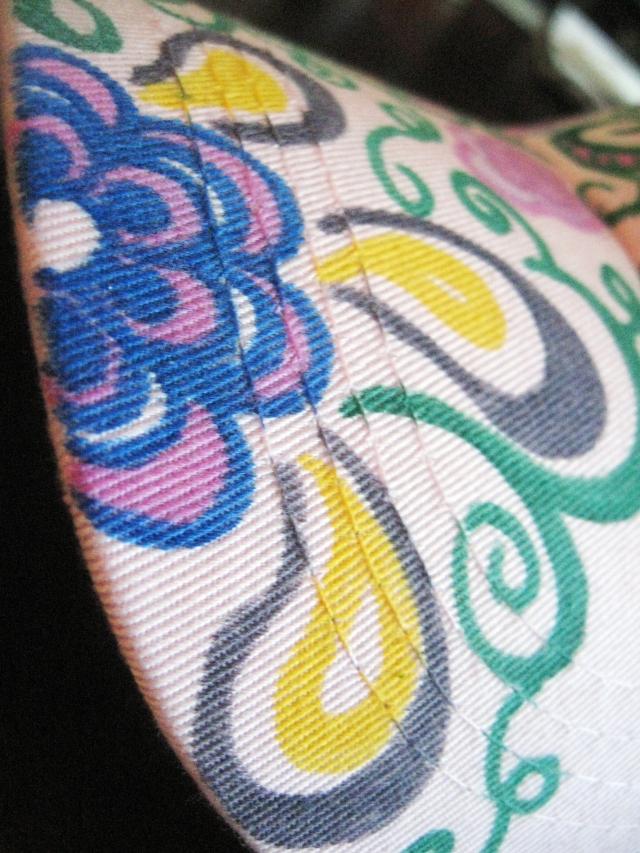 Flower doodles on brim of hat